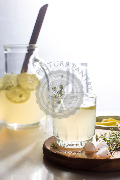 Thyme lemonade in a glass pitcher