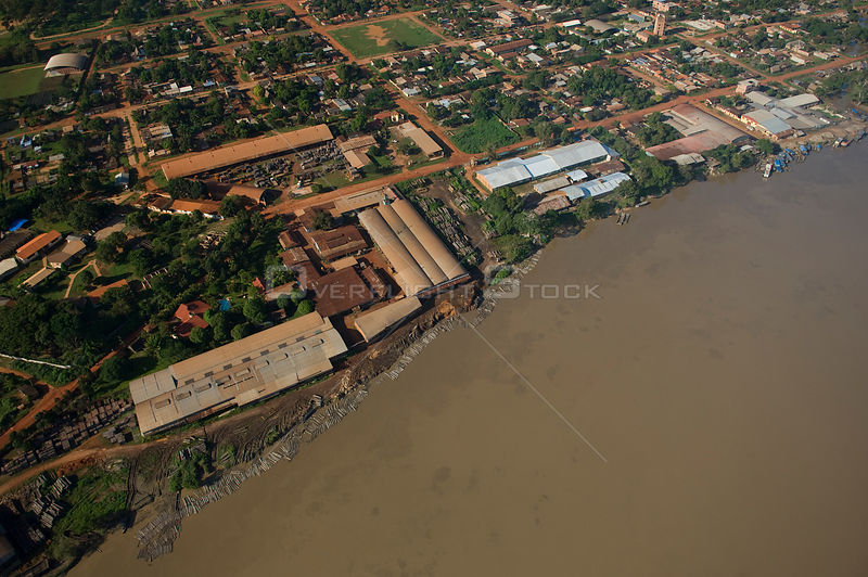 Aerial view of saw-mills and timber from the Amazon Rainforest on the margin of Beni River, Riberalta town, Beni Department, Bolivia.