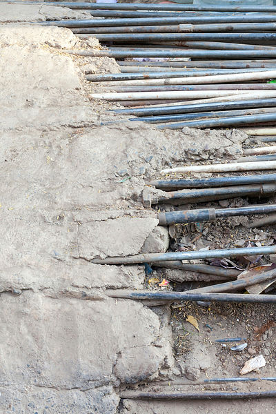 India - Delhi - A tangle of illegal water pipes in the Munika area