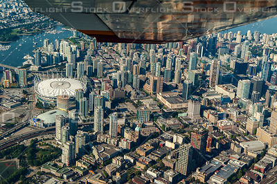 Cessna Airplane Wing Over Downtown Vancouver