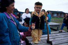 A young native Americn boy in costume.