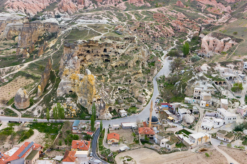 Aerial photograph of the Tufa rock formations and landscape including the Rock Church of St John the Baptist in Cavusin, Cappadocia, Anatolia, Turkey, 2008