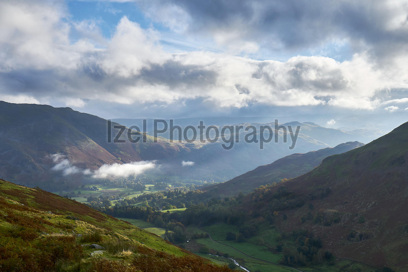 Looking down the trail towards Patterdale and Glenridding that leads up to the Hole in the Wall below Helvellyn in the Lake District, England, UK.