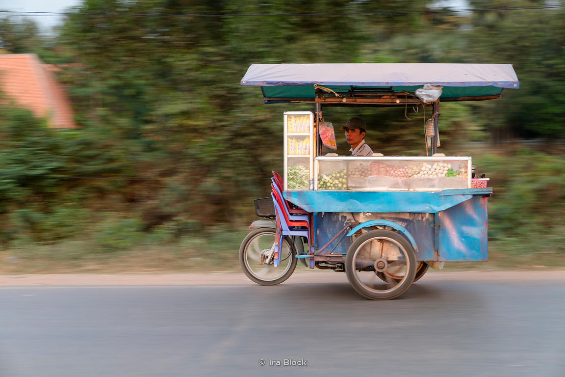 Locals pass by on the streets of Siem Reap in Cambodia.