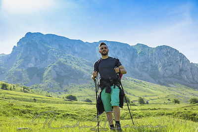 Man Hiking in Green Mountains