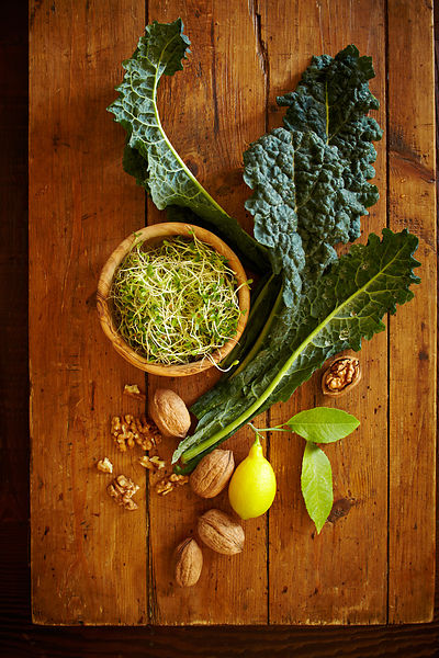 Still life with kale, lemon, walnuts & sprouts