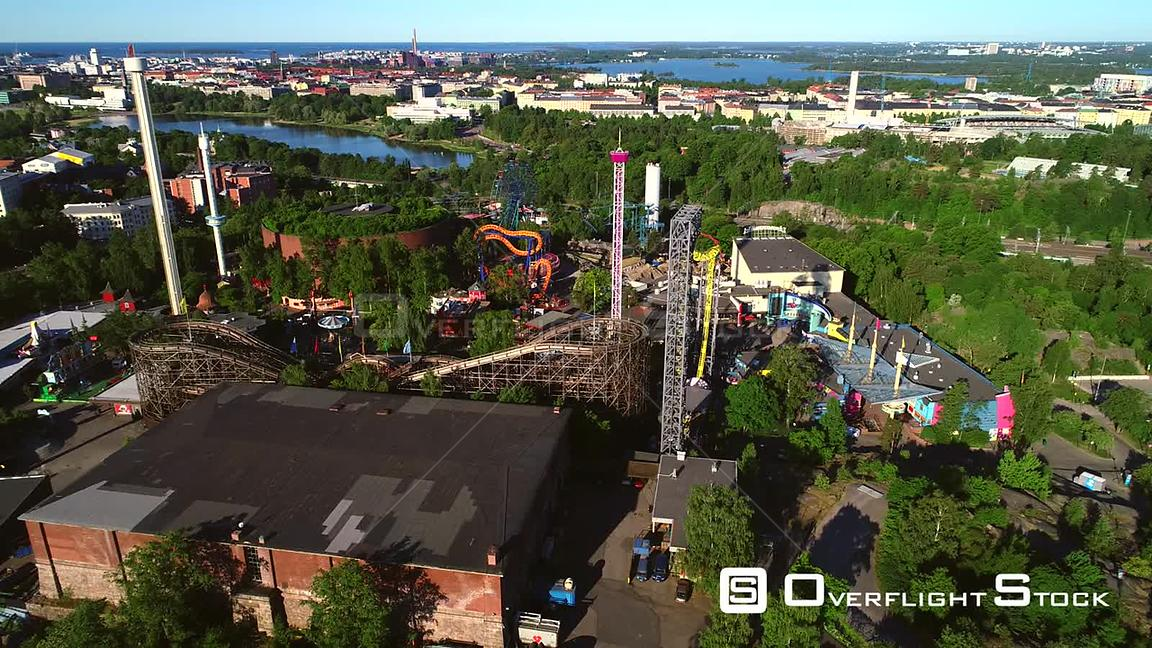 Linnanmaki, Aerial Descending Tilt View of the Helsinki Amusement Park, on a Sunny Summer Morning Dawn, in Helsingfors, Uusimaa, Finland