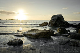 Sunset on rocky beach