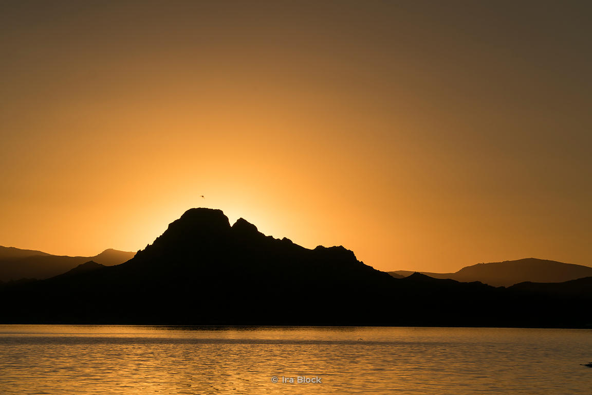 Sunset behind a small mountain at Tolbo Lake in western Mongolia in Bayant-Ölgii province.