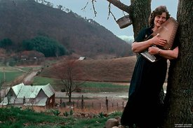 Janette Carter holds harp in Poor Valley, VA