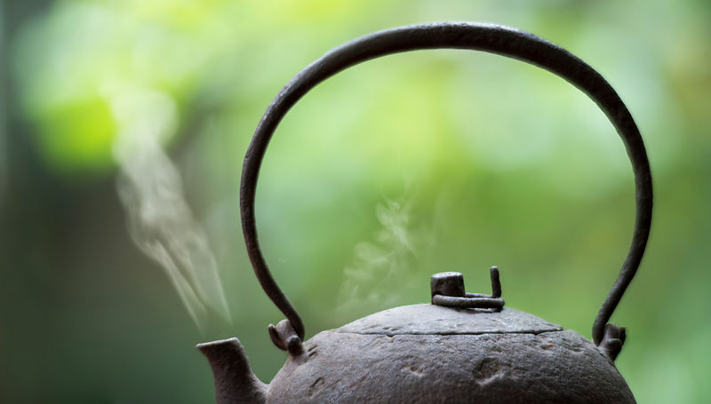 Iron kettle boiling water