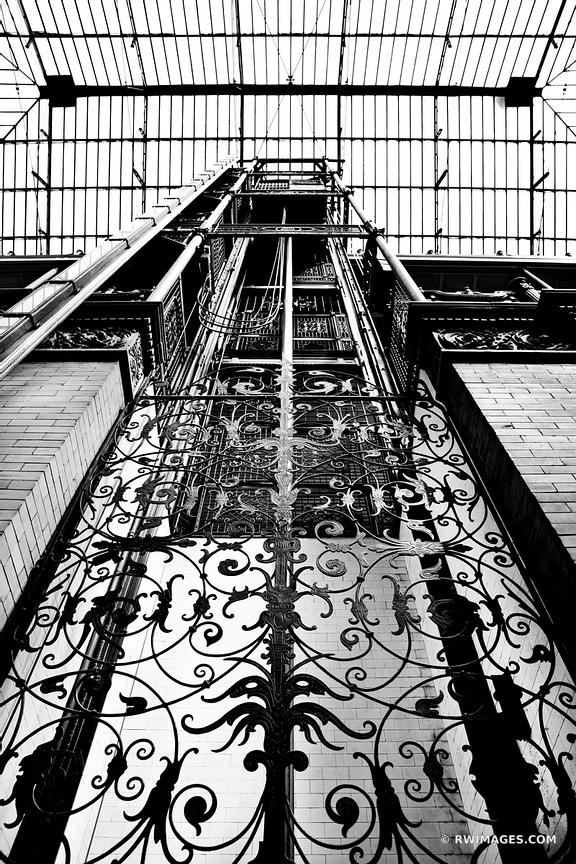 VINTAGE ELEVATOR BRADBURY BUILDING HISTORIC LOS ANGELES CALIFORNIA BLACK AND WHITE VERTICAL