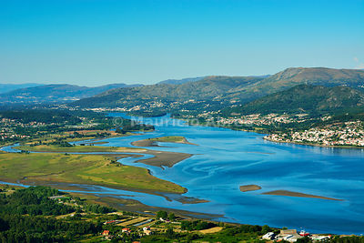 Minho river between Portugal and Spain. Portugal on the background and spanish Galicia on the foreground. Portugal