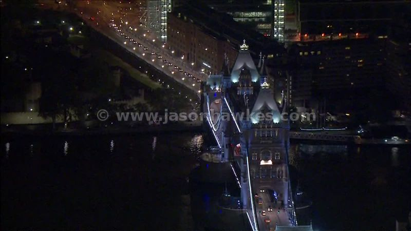 Aerial footage around Tower Bridge at night, London, England, UK
