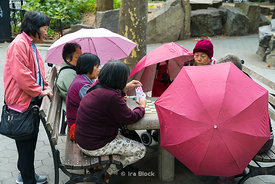 Women playing cards in Columbus Park in Chinatown, New York City