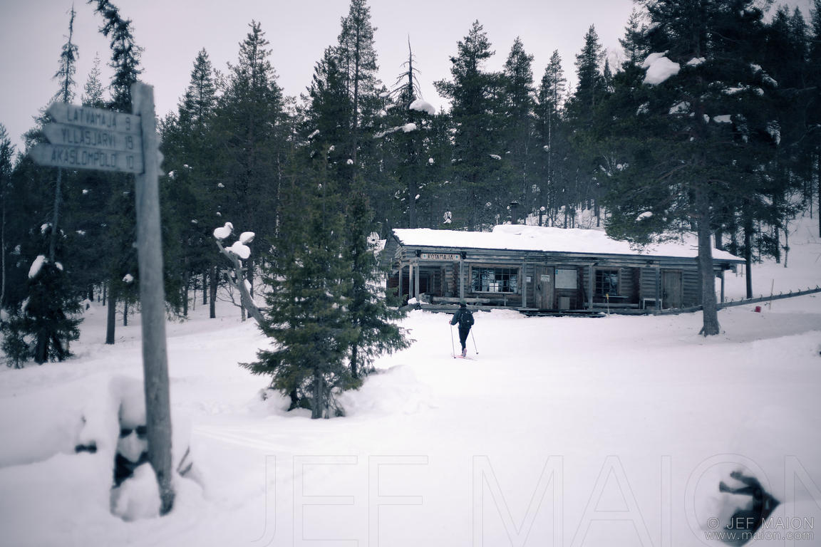 Skier arriving at wilderness hut