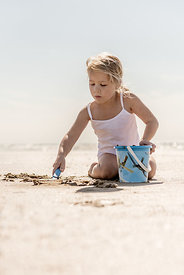 Girl playing on the beach 5