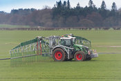 Spreading slurry with an umbilical system on a Fendt 828 tractor, to minimise soil compaction. North Yorkshire, UK.