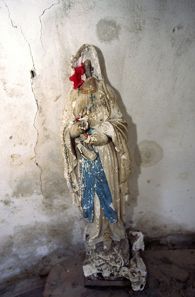 Desecrated statue of the Virgin Mary in Thethi, Albania. Religion was banned under the Communist regime