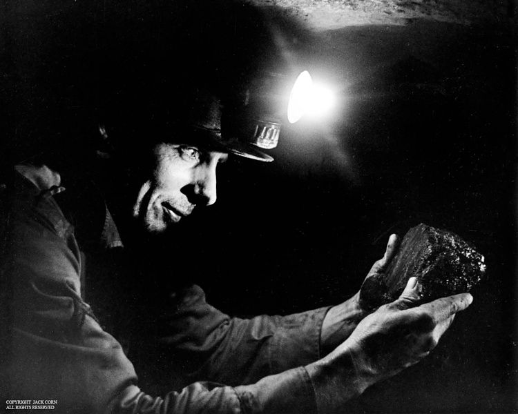Miner holding lump of coal