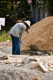 Young woman mixing cement