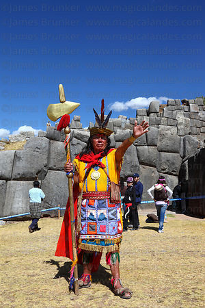 The Inca holding a golden sceptre with maize symbol at Sacsayhuaman during Inti Raymi festival, Cusco, Peru