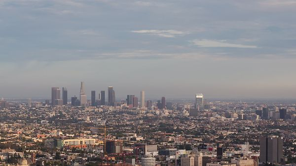 Bird's Eye: Dramatic Sunset Ruled By Cloud Shadows Over Los Angeles