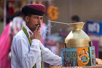 Chai wallah smoking a cigarette, Pushkar, Rajasthan, India