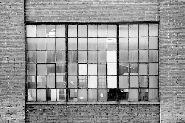INDUSTRIAL WAREHOUSE BRICK WALL AND WINDOW PORTLAND MAINE BLACK AND WHITE