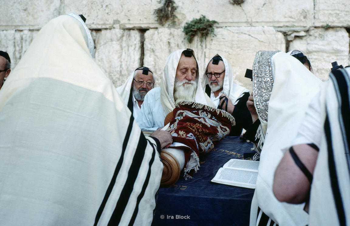 Jews with Torah in the Western Wall, old city of Jerusalem, Israel