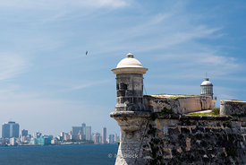Morro Castle, a fortress guarding the entrance to Havana bay with background of Centro Havana in Havana, Cuba.