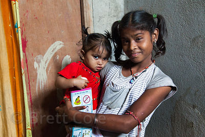 A girl and her younger sister at the Swastha Kendra Clinic operated by the NGO Calcutta Kids (calcuttakids.org), in Howrah, India