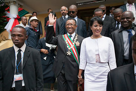 The new president of Madagascar Hery Rajaonarimampianina (C) and his wife take part in the inaugural ceremony for his presidency at the Mahamasina Stadium in Antananarivo on January 25, 2014. The new president of Madagascar Hery Rajaonarimampianina announced a policy of national unity and declared he would reach out to the opposing camp of former President Marc Ravalomanana, during his inauguration in Antananarivo.
