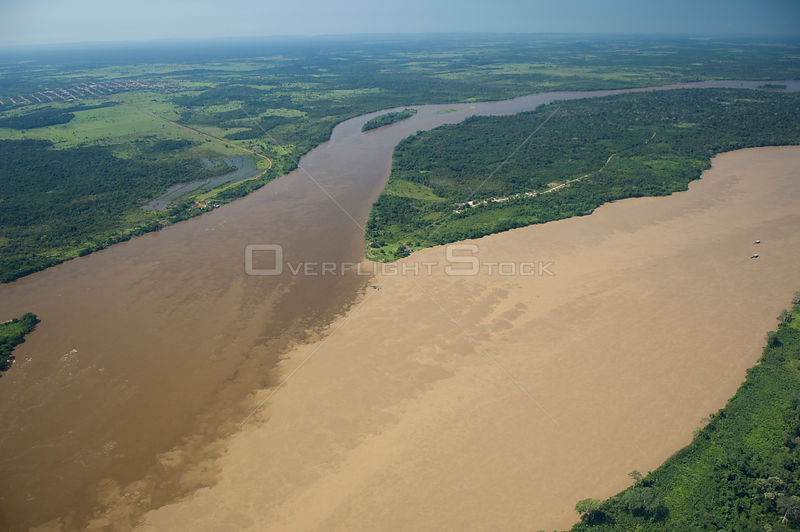 Aerial view of Madeira River, where it is formed by the meeting of the waters of Beni River (clearer water, left) and Mamoré River at the border of Brazil (Rondônia State) and Bolivia (Beni Department).