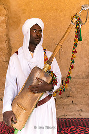Portrait of a musician in the Moroccan village of Khamila, founded in the 1950's near Erg Chebbi, Sand dunes area of the Sahara in Morocco