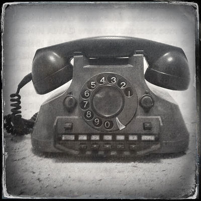 Old retro telephone with old fashioned wet plate filter effect .Cologne, Germany