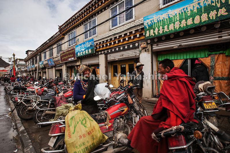 A hundred years ago, Tibetan horses would have been tied up in front of these storefronts in Serxu, but today, the motorcycle is the nomad's preferred means of transport.