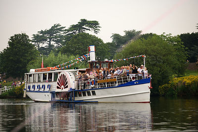 The Yarmouth Belle Pleasure Boat follows the Olympic Flame to Tower Bridge