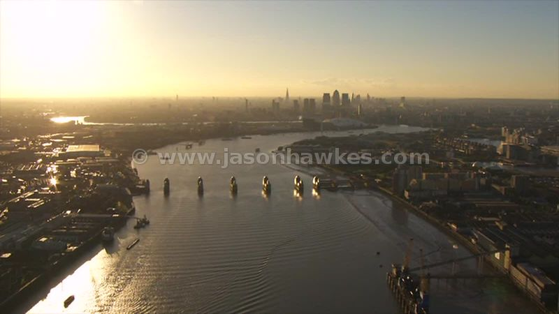 Aerial footage from the Thames Barrier to the Greenwich Peninsula, London