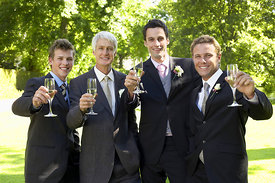 Men Toasting Champagne Flutes At Wedding
