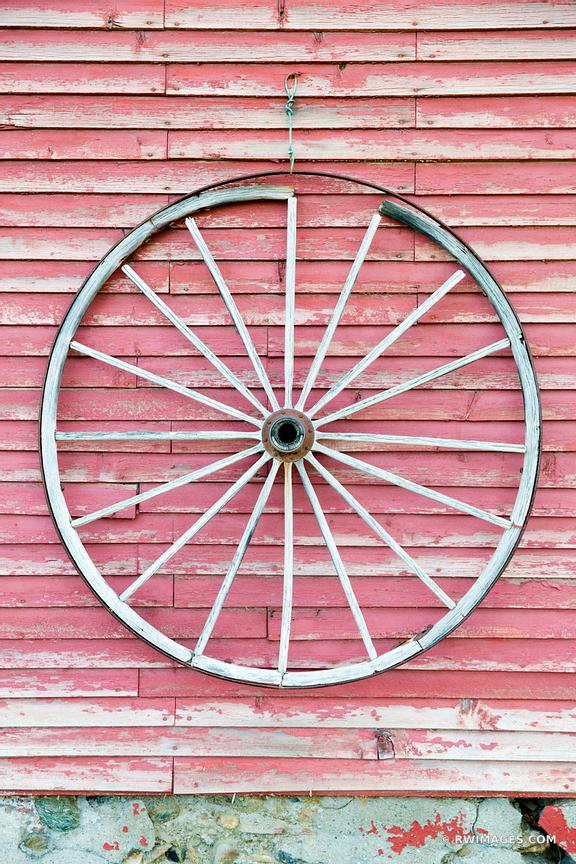 VINTAGE WOODEN WAGON WHEEL ON A WEATHERED RED BARN WALL VERMONT COLOR