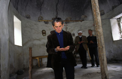 Albania - Thethi - Pashke Sokol Ndocaj (r) at prayer in the ruined mosque at Thethi