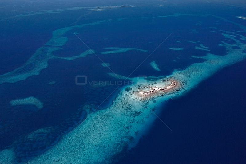 Aerial view of Laughing Bird Caye, a narrow sand caye, Laughing Bird Caye National Park, southern Belize barrier reef. Belize Barrier Reef Reserve System UNESCO Natural World Heritage Site, Central America. Caribbean Sea.