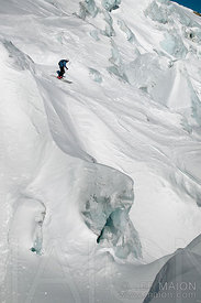 Skier on steep glacier