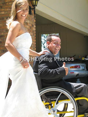 man in wheelchair with his bride getting married