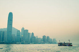 star ferry over victoria harbour of hong kong skyline