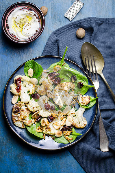 Spinach, roasted cauliflower salad with almond and cranberries