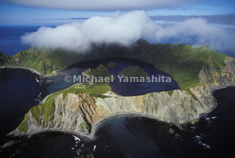 A laboratory for hardy scientists, the crater bay on uninhabited Yankicha teems with marine life, the product of an unusual environment in which cold ocean tides mingle with superheated waters from volcanic vents.