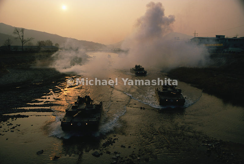 "Tanks on a training mission cross a river near Seoul, which North Korea has threatened to turn into a ""lake of fire."""