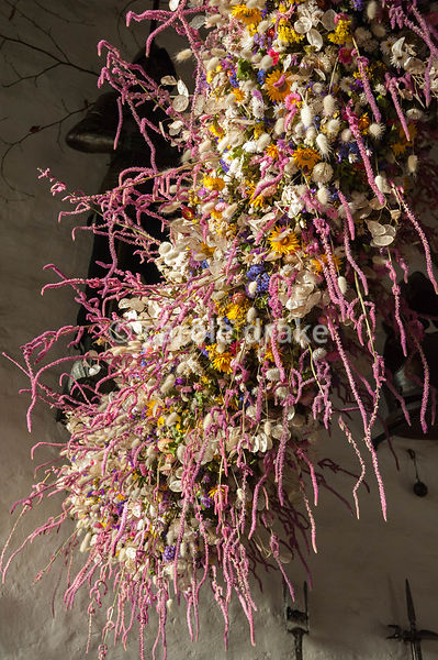 Section of the 60' long dried flower garland made from over 30,000 dried flowers and grasses inserted into a pittosporum base hanging in the Great Hall at Christmas. Cotehele, St Dominick, nr Saltash, Cornwall, UK